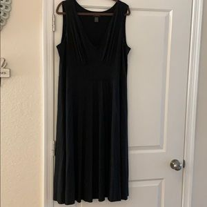 Black pleated V-neck dress.